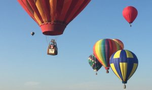 a group of hot air balloons in the sky 300x177 - a-group-of-hot-air-balloons-in-the-sky