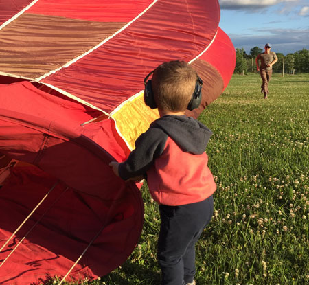 child helping with a hot air balloon - History