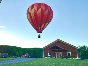 haot air balloon floating over a barn 300x225 - haot-air-balloon-floating-over-a-barn