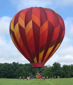 hot air balloon landing on the ground 255x300 - hot-air-balloon-landing-on-the-ground