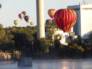 hot air balloons floating above a river 300x225 - hot-air-balloons-floating-above-a-river