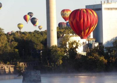 hot-air-balloons-floating-above-a-river