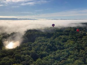 hot air balloons floating over trees 300x225 - hot-air-balloons-floating-over-trees