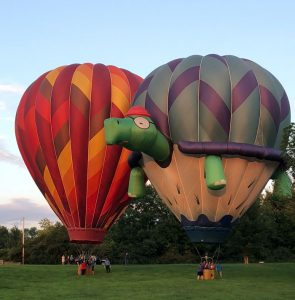hot air balloons standing up on the ground 295x300 - hot-air-balloons-standing-up-on-the-ground