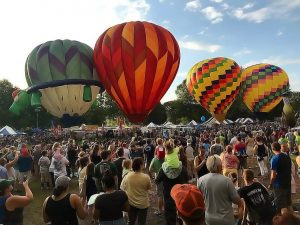 hot air balloons surrounded by crowds of people in binghamton 300x225 - hot-air-balloons-surrounded-by-crowds-of-people-in-binghamton
